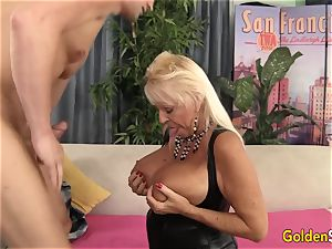 Floppy boobed grannie humps a smooth-shaven man