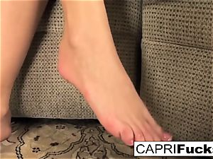 Capri plays with her honeypot and feet