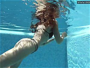 Tiffany Tatum disrobes nude underwater