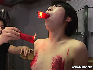 japanese biotch loves to be domination & submission treated to a paraffin wax flash